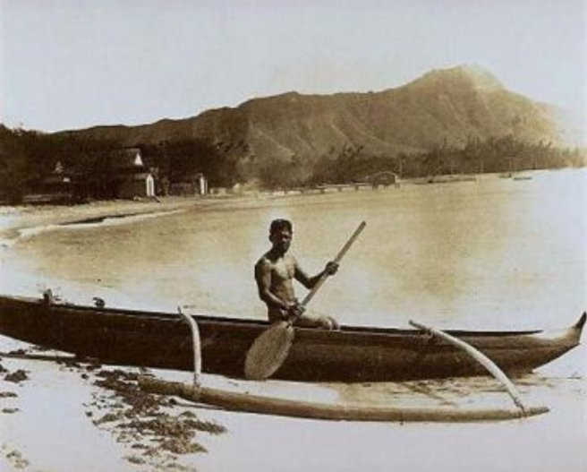 Vintage outrigger canoe on Hawaiian shore